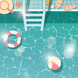 Swimming pool side, top view, summer time holiday vacation, clear water with beach items Royalty Free Stock Images