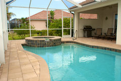 Swimming pool and sitting area stock photo