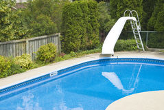 Swimming Pool with a Slide Stock Photography