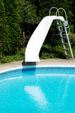 Swimming Pool with a Slide Stock Photos