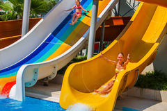 Swimming pool slides for children on water slide at aquapark. Royalty Free Stock Image