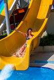 Swimming pool slides for woman on water slide at aquapark. Stock Photography