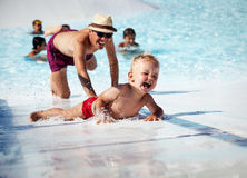 In swimming pool. Son and his father play in the swimming pool Royalty Free Stock Images