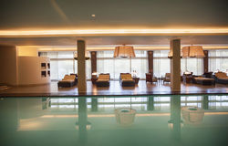Swimming pool. Spa swimming pool with relax chairs Royalty Free Stock Photo