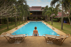 Swimming pool in spa resort in Thailand royalty free stock photo