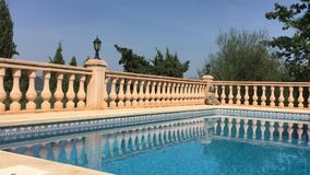 Swimming pool in Spain. Calm waters of a swimming pool in Spain stock footage