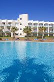 Swimming pool in Spanish hotel with palm trees stock photography
