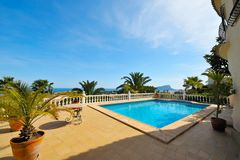Swimming pool and a spectacular view. Swimming pool with blue water in the yard of a luxury house and a spectacular view Stock Images