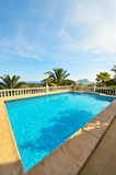Swimming pool with a spectacular view. Swimming pool with blue water in the yard of a luxury house and a spectacular view Royalty Free Stock Images