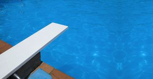 Swimming pool springboard. Springboard to dive at the swimming pool stock image