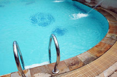 Swimming pool. With stainless ladder Stock Photography