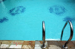 Swimming pool. With stainless ladder Stock Images