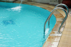 Swimming pool. With stainless ladder Royalty Free Stock Image