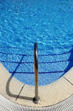 Swimming pool, stainless steel ladder Royalty Free Stock Photography
