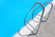 Swimming pool stair. A Swimming pool steel stair Royalty Free Stock Images