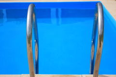 Swimming pool stair Stock Images