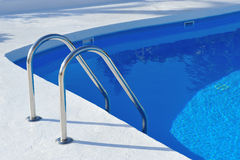Swimming pool with stair royalty free stock photography