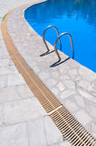 Swimming pool stair Stock Photo