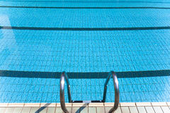 Swimming pool with stair Royalty Free Stock Photo