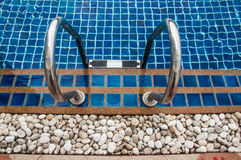 Swimming pool with stair Royalty Free Stock Image