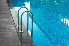 Swimming pool. Stair down at Royalty Free Stock Images