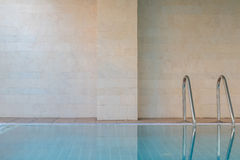 Swimming pool with stair and granite wall - healthy backgroud Royalty Free Stock Photography
