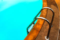 Swimming pool with stair. Green swimming pool with stair at hotel Royalty Free Stock Image