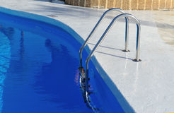 Swimming pool with stair at hotel stock image