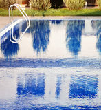 Swimming pool with stair at hotel Royalty Free Stock Photography