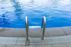 Swimming pool stair at hotel Stock Photography