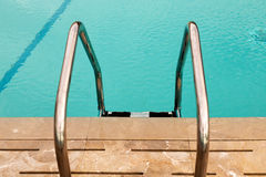 Swimming pool with stair at hotel Stock Photography