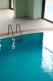 Swimming pool with stair at hotel close up Royalty Free Stock Images