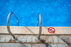 Swimming pool with stair at hotel close up Stock Image