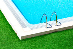 Swimming pool with stair at hotel close up Royalty Free Stock Photos