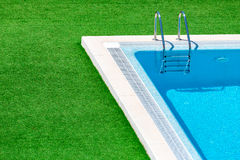 Swimming pool with stair in hotel resort Royalty Free Stock Photos