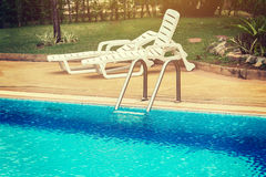 Swimming pool with stair at hotel Royalty Free Stock Photo