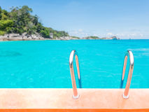 Swimming pool stair over sea background Royalty Free Stock Photos