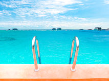 Swimming pool stair over sea background Stock Photography