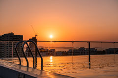 Swimming pool with stair on rooftop in the city in summer sunset Stock Image