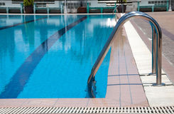 Swimming pool with stair at sport center Stock Photos