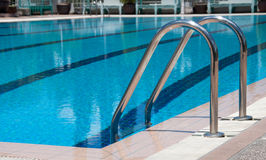 Swimming pool with stair at sport center Royalty Free Stock Photos