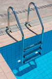 Swimming pool with stair at sport center Royalty Free Stock Photography