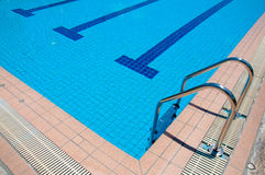 Swimming pool with stair at sport center Royalty Free Stock Images