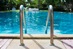 Swimming pool with stair. And wooden deck stock photography