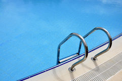 Swimming pool staircase and clear water Stock Photo