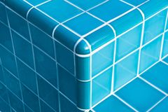 Swimming pool staircase tiles in close-up detail stock photography
