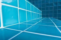 Swimming pool staircase tiles in close-up detail royalty free stock image
