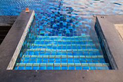 Swimming pool with stairs. Royalty Free Stock Photography