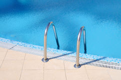 Swimming pool with stairs Royalty Free Stock Image