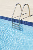 Swimming pool with stairs Royalty Free Stock Photos